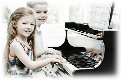 Two happy children playing on the piano